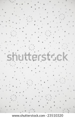 Natural rice paper with fancy design of embossed tiny silver stars and pinwheels - stock photo