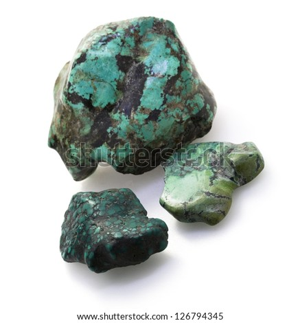 Natural rough turquoise rocks on the white background.