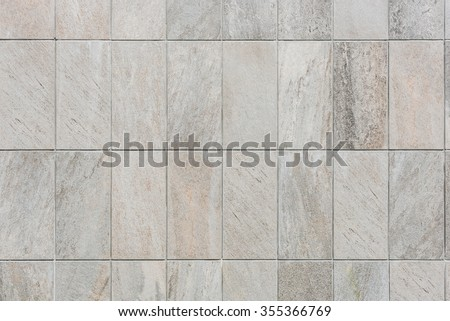natural sand stone tile wall seamless background and texture - stock photo