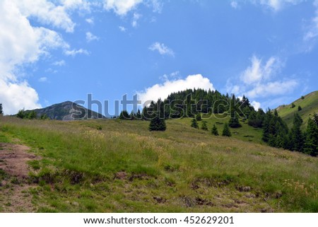 Natural scenery with mountain view and cloudy sky.