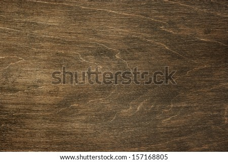 Natural scratched dark wood texture as background. - stock photo