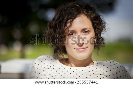 Natural Serious Woman Looking At The Camera - stock photo