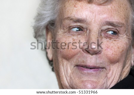 natural shot of an elderly lady in her 70s smiling