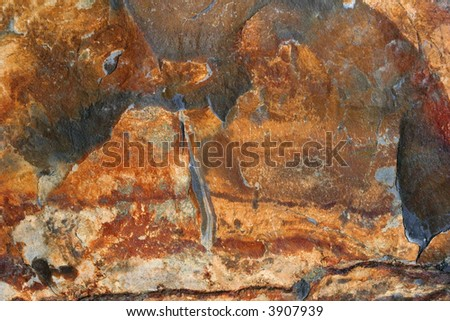 Natural slate with shades of red, brown, gold and black. - stock photo