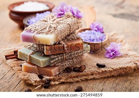 Natural soap and s?lt on wooden background - stock photo