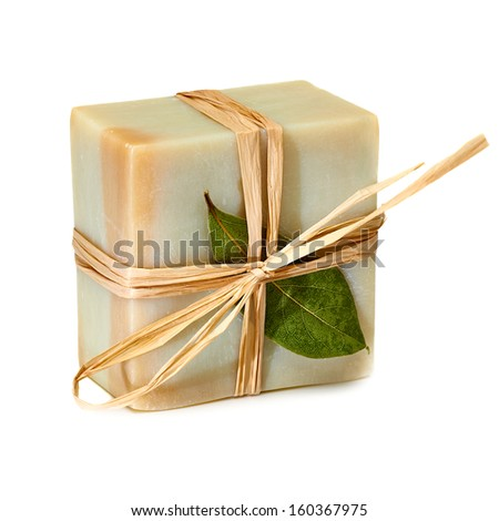 Natural soap packed with leaf on white background - stock photo