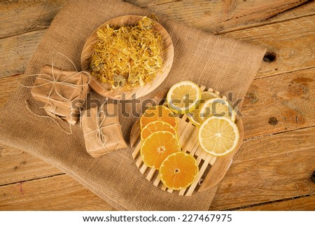 Natural soap  surrounded by some of its ingredients - stock photo