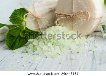 Natural soap with salt and mint herbs - stock photo