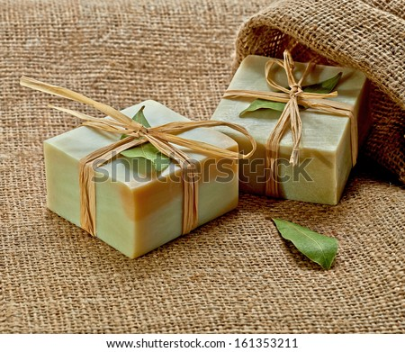 Natural soaps on burlap - stock photo
