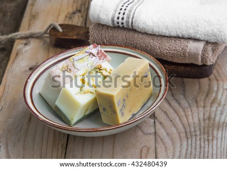 Natural soaps spa setting with towels - stock photo