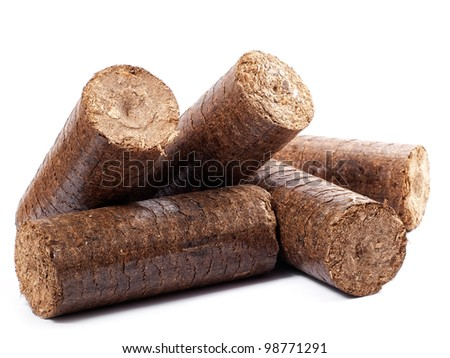 Natural source of energy in the form of wooden briquettes on a white background. - stock photo