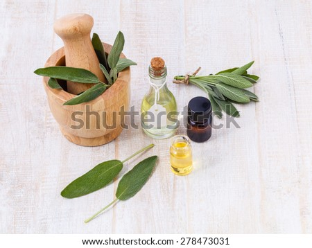 Natural Spa Ingredients  sage essential oil for aromatherapy. - stock photo