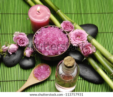 Natural spa setting on gren mat - stock photo