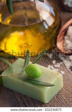 Natural spa setting with olive and olive oil products: bath salt, natural soap and olive oil. - stock photo