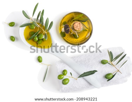 Natural spa setting with olives and olive oil, top view on white - stock photo