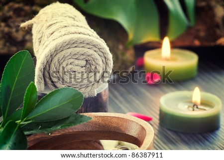 Natural spa setting with rose water and towel. - stock photo