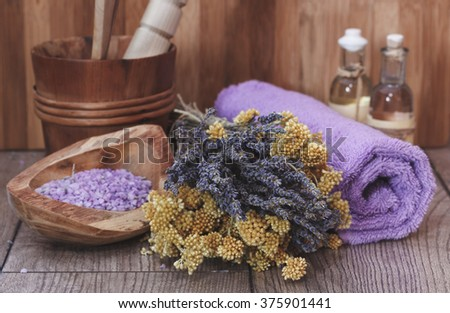 Natural spa treatment with lavender and helichrysum (immortelle). Macro selective focus with retro style processing - stock photo