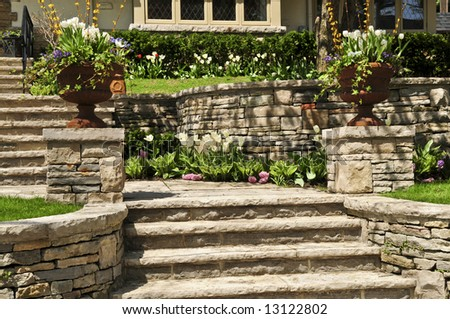 Natural stone landscaping in front of a house - stock photo