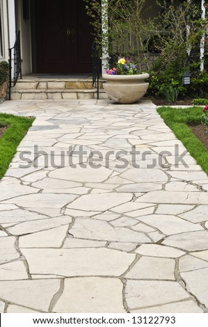Natural stone path leading to a house, landscaping element - stock photo