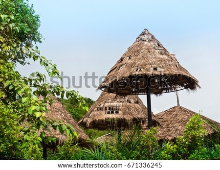 Natural Straw Roofs In The Park On Blue Sky Background