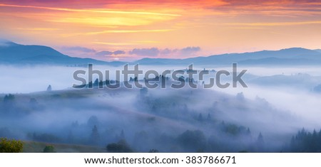 Natural summer scene in the mountain valley. Foggy morning in Carpathian mountains. Ukraine, Europe. - stock photo