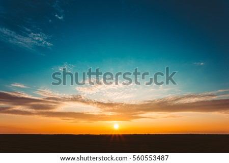 stock photo natural sunset sunrise over field or meadow bright dramatic sky and dark ground countryside 560553487 - Каталог — Фотообои «Закаты, рассветы»