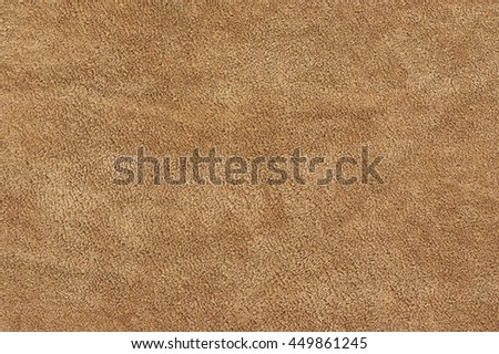 Natural tan color suede texture as background.