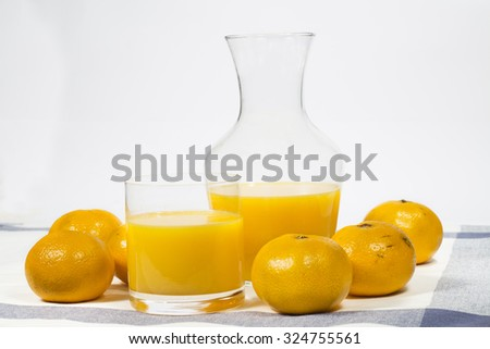 Natural tangerine orange juice on white