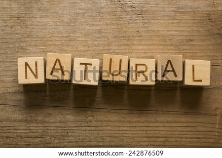 Natural text on a wooden blocks on a wooden background - stock photo
