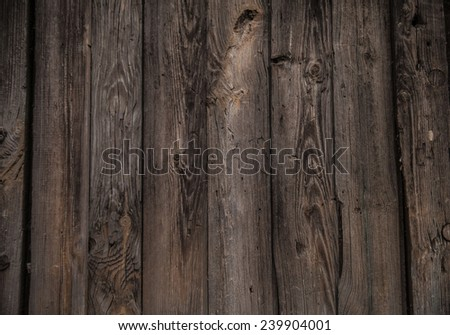 Natural texture backdrop of old retro vintage aged bronwn wooden board plank table or wall house fence floor background with dark frame Metal nails hammered Empty copy space for inscription - stock photo