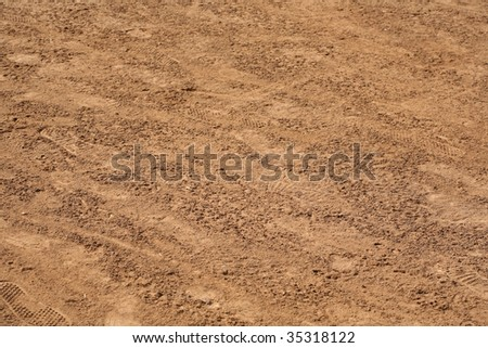 Natural texture background of dirt with footprints - stock photo