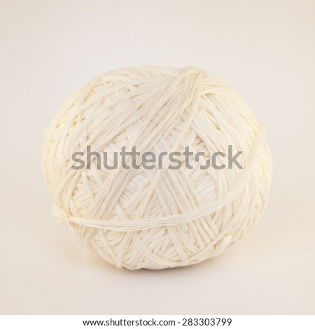 Natural Textured Two White Single Sheep Wool Roll or Ball or Tangle Closeup On Rustic Wood Table or Board or Floor  Background - stock photo