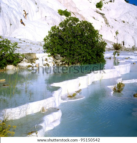 Natural travertine pools and terraces, Pamukkale, Turkey, World Heritage Site by UNESCO - stock photo