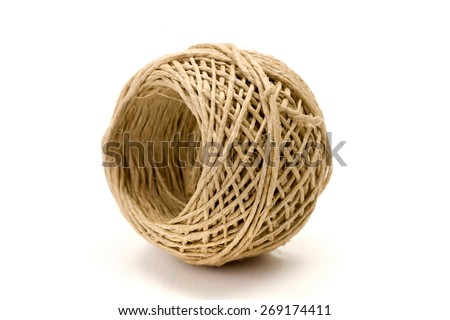 Natural twisted hemp cord reel on white background - stock photo