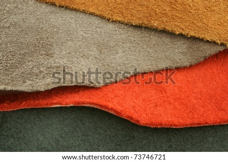 Natural variegated suede background closeup - stock photo