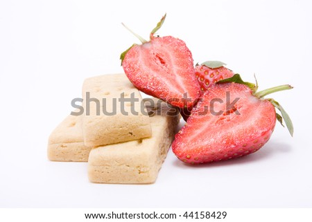 Natural vibrant red Strawberry and shortbread isolated against white background.