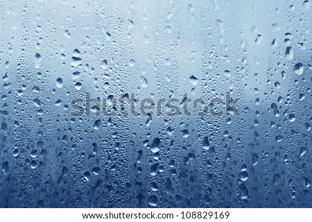 Natural water drops on glass - stock photo