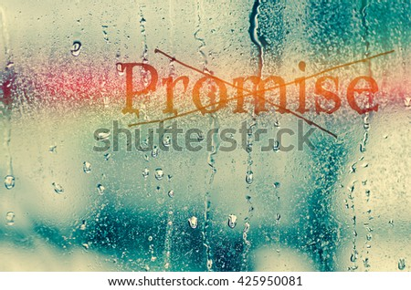 """natural water drops on glass window with the text """"Promise"""" - stock photo"""