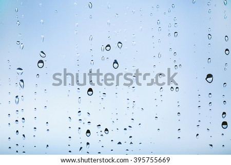 Natural water drops on the window. Abstract background. Drops closeup. - stock photo