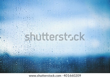 Natural water drops on the window. Abstract background. Drops closeup. Selective focus. - stock photo