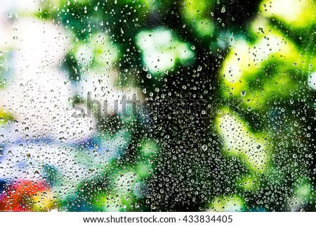 natural water drops on window glass with green background. - stock photo