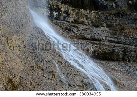 Natural waterfall and cascade in wild