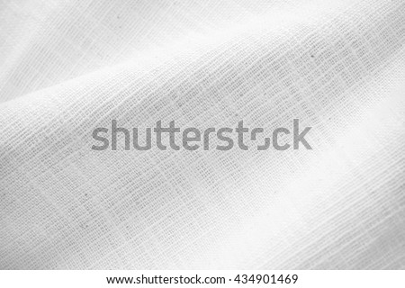 natural white linen texture. linen pattern fabric for design or background. sackcloth textured. Image has shallow depth of field. - stock photo