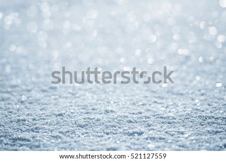 Natural winter background of defocused snow with copy space