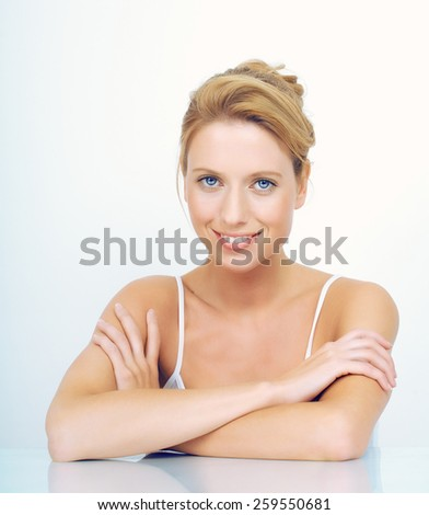 Natural woman sitting with dreamy expressions. - stock photo