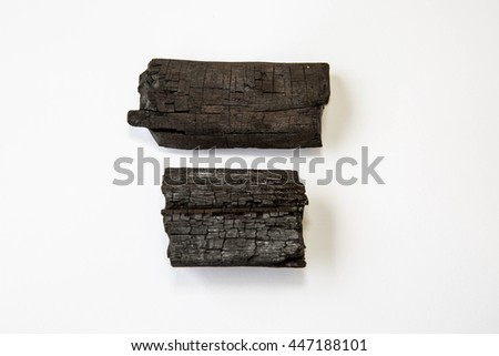 Natural wood charcoal Isolated on white, traditional charcoal or hard wood charcoal - stock photo