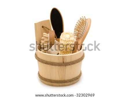 Natural wood toiletry accessories in a wooden bucket - stock photo