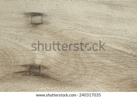Natural wooden background with wooded rivet inside - stock photo