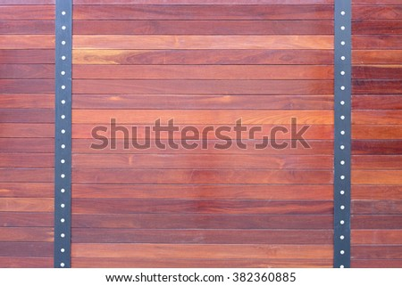 natural wooden fence texture with nuts - stock photo