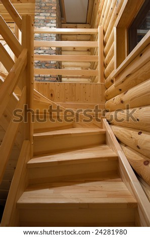 Natural wooden, pine stairs in home.